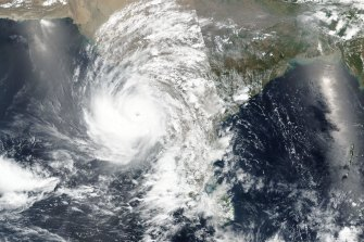 An image released by NASA shows the cyclone approaching western India.