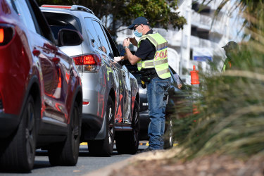 Police direct motorists at the Coolangatta border check point on Griffith St this week.