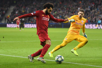 Mohamed Salah scores Liverpool's second goal against Salzburg.