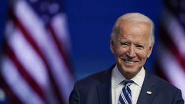 President-elect Joe Biden smiles as he speaks at The Queen theatre in Wilmington, Delaware.