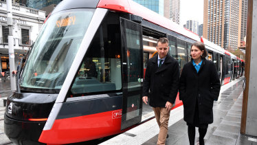 Transport Minister Andrew Constance and Premier Gladys Berejiklian inspect the first tram to reach Circular Quay, the northern end of a new light rail line from the CBD to Sydney's south east.