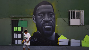 A mural depicting George Floyd in the Watts neighbourhood of Los Angeles.