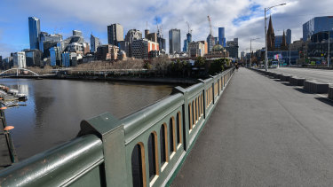 A quiet Princes Bridge in Melbourne as stage four lockdown restrictions take effect.