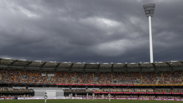 Rain clouds gather over play on day two of the fourth Test between India and Australia at the Gabba on Saturday.
