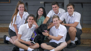 Michael Syme and Mitch Hart (front), with Ebony Llewelyn, Kayla Jenkins, Lachlan Shield and Charlie Wakeham (rear) and the school's therapy dog - Europa.