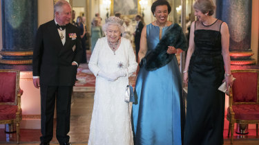 Baroness Scotland with Prince Charles, the Queen and then British prime minister Theresa May.