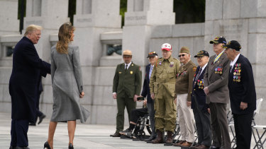 Veterans talk with President Donald Trump and first lady Melania Trump during a ceremony at the World War II Memorial to commemorate the 75th anniversary of Victory in Europe Day.