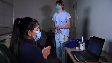 Specialist Anaesthetist Amy Lawrence (right) and testing team member Kritika Bhargava (left) during mask fit testing at Concord Repatriation General Hospital.