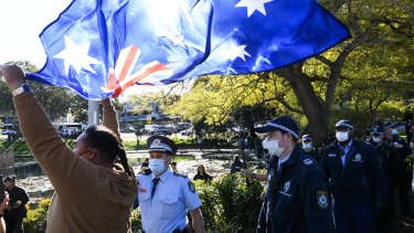 Thousands of people marched through Sydney in protest of  Sydney's lockdown on Saturday.