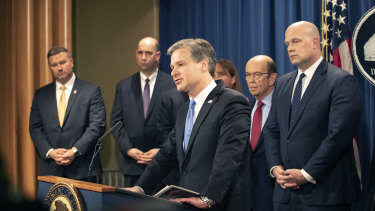 FBI director Christopher Wray speaks at a press conference announcing charges against Huawei.