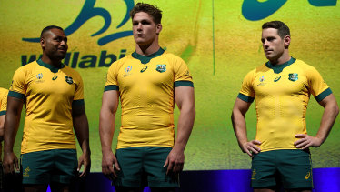 No sign of Izzy: Wallabies Samu Kerevi, left, Michael Hooper and Bernard Foley at the launch of the official World Cup jersey in Sydney on Wednesday.