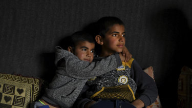 Anas Azad, 4, hugs his nine-year-old brother, Ayham Azad, at their home in Sharya village, Iraq. The boys were were kidnapped by IS and forced to live with them.