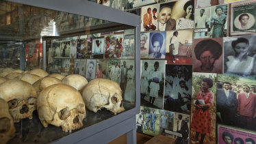 Skulls of some of those who were slaughtered as they sought refuge in the Catholic Church in Ntarama, Rwanda, are placed in a glass case next to photographs of some of them, kept as a memorial to the thousands who were killed in and around the church during the 1994 genocide.