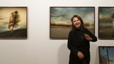 Tracey Moffatt in the storeroom of the Roslyn Oxley9 Gallery for a test hang of Portals.