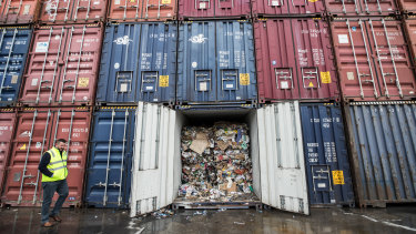 "Containers filled with waste languish after SKM""s collapse"