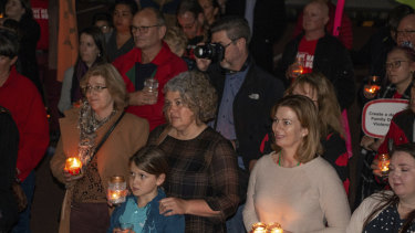 The vigil highted the concerns of child protection workers about increased workloads, burnout and the effects on the children who need support.