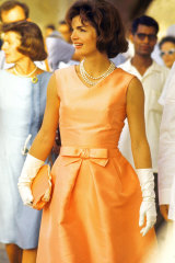 Jackie Kennedy Onassis often wore white gloves and pearls on official visits.