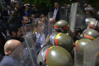 Guaido and his allies are blocked from entering parliament by National Guard troops with riot shields.