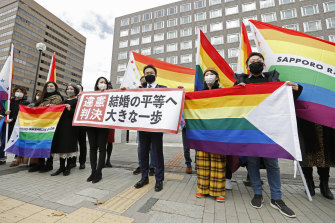 """Supporters of same-sex marriage outside Sapporo District Court on Wednesday. The banner reads: """"Unconstitutional judgment."""""""