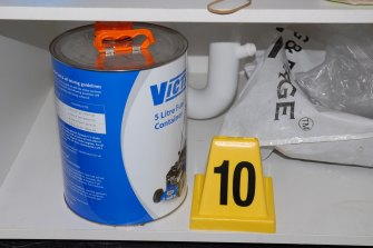 A Victa fuel tin found in the laundry of the Rouse Hill home.