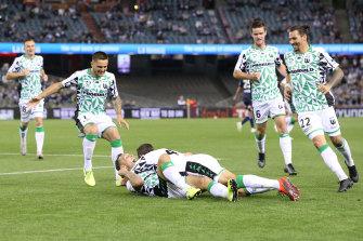 Western United celebrate after striker Scott McDonald's goal.