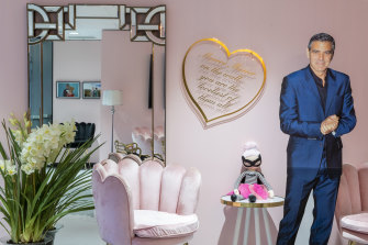 "Burmeister's Melbourne clinic, known as the ""pink palace"", features George Clooney in life-size cardboard."