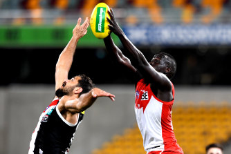 Sydney's Aliir Aliir and Paddy Ryder of the Saints battle for the ball.