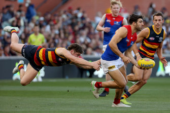 Christian Petracca tackled by Harry Schoenberg.