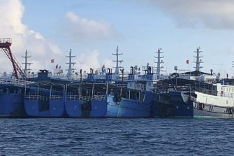 In this photo provided by the National Task Force-West Philippine Sea, Chinese vessels are moored at Whitsun Reef, South China Sea on March 27, 2021.