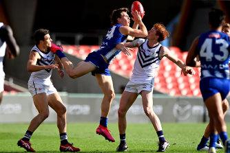North Melbourne's Cameron Zurhaar takes a mark.