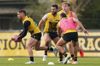 Dion Prestia runs with the ball during an AFL Richmond Tigers training session at Punt Road Oval, in Melbourne, on Thursday.
