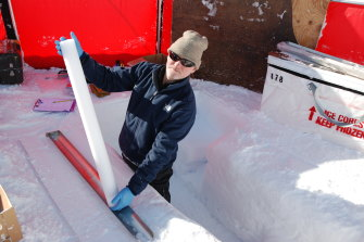 Andrew Smith, a senior principal research scientist at ANSTO, with one of the extracted ice cores.
