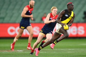 Mabior Chol on the run against the Demons.