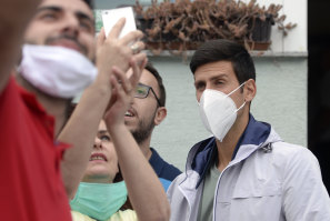 Djokovic is mobbed by fans last month during his first public appearance since recovering from COVID-19.