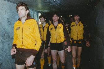 Hawthorn captain Michael Tuck leads the Hawks out for the 1991 grand final.