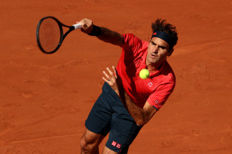 Roger Federer serves in his first-round match against Denis Istomin.