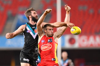 Port's Justin Westhoff battles the Suns' Sam Day for the ball.