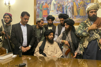 Taliban fighters take control of the Afghan presidential palace.