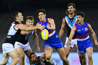 Lewis Young of the Bulldogs handballs during the Bulldogs' loss to Port Adelaide on Friday night.