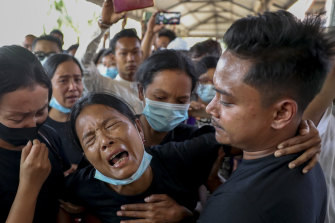 Mourners weeping at a funeral for a protester in Mandalay in February, 2021. Witnesses said the military shot at mourners at a funeral in Yangon on Sunday.