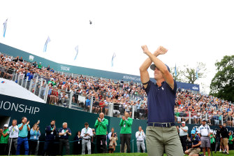 """Billy Horschel makes the West Ham United """"Irons"""" sign after winning the BMW PGA Championship in England."""