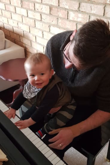 Elliot Paterson, with dad Hugh, loves music.