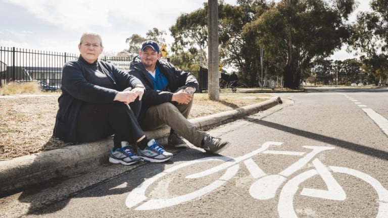 """Philippa Horner and Southside market manager Wayne Skein sit next to where people are being fined. There has been a recent """"spike"""" in infringements being issued."""