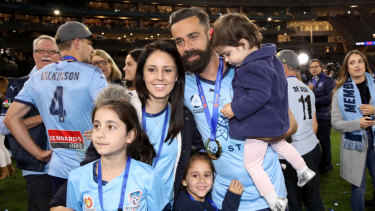 Fond farewell: Alex Brosque with his family after Sydney FC won the A-League grand final on Sunday night.