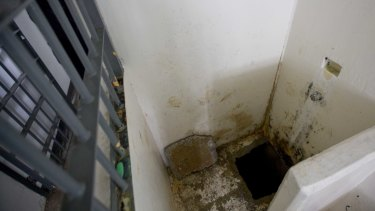 The jail cell shower area where drug lord  El Chapo slipped into a tunnel to escape from the Mexican Altiplano maximum security prison in 2015.