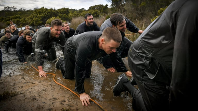 Victorian cricketers get down and dirty during the intense camp.