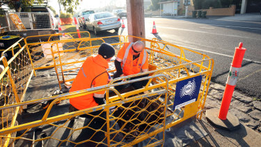 NBN workers lay the cable as the roll-out nears its final stage.