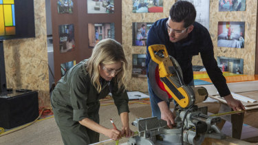 Maureen McCormick (left) working on the Brady house renovation.