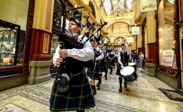 Lead on: Scotch College Pipes and Drums Band members in Block Arcade to launch the inaugural Melbourne Tartan Festival