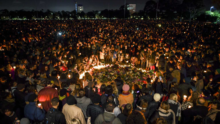 Thousand of people attend a candlelight vigil in solidarity for the Melbourne comedian Eurydice Dixon.